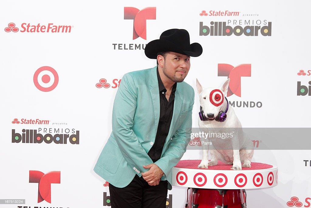 Roberto Tapia celebrates with Bullseye, Target's Beloved Bull Terrier Mascot, at the 2013 Billboard Latin Music Awards at BankUnited Center on April 25, 2013 in Miami, Florida.