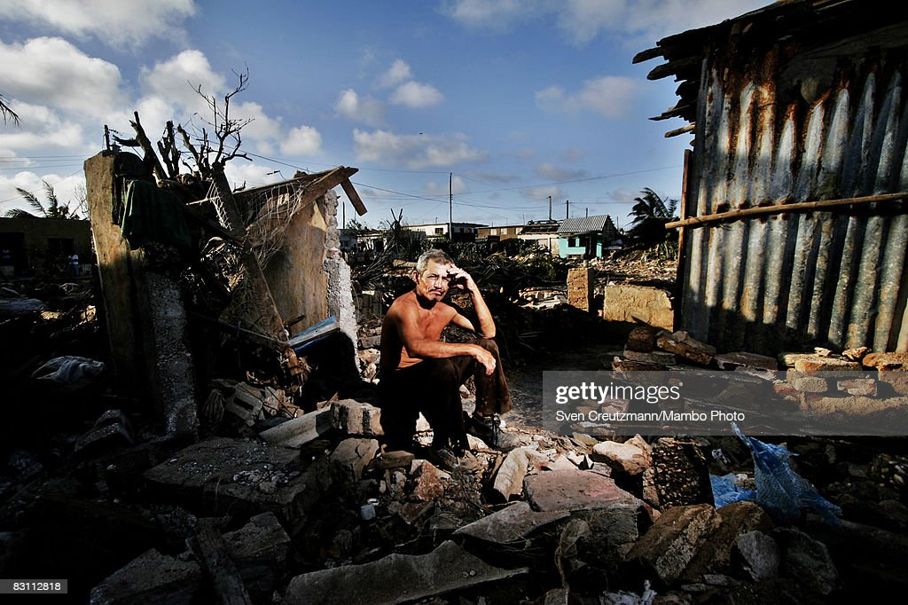 Roberto Velazquez 49yearsold sits atop a pile of ruble of what used to be his house after Hurricane Ike tore through a week earlier September 15 2008...