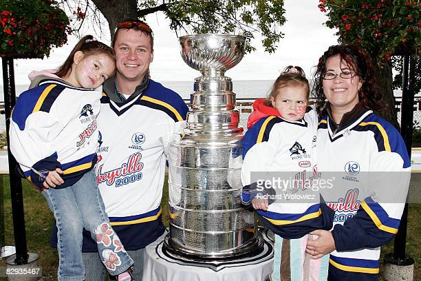Roberval 2008 Kraft Hockeyville organizing committee member MarieEve Sasseville and family pose with the Stanley Cup during the 2008 Kraft...
