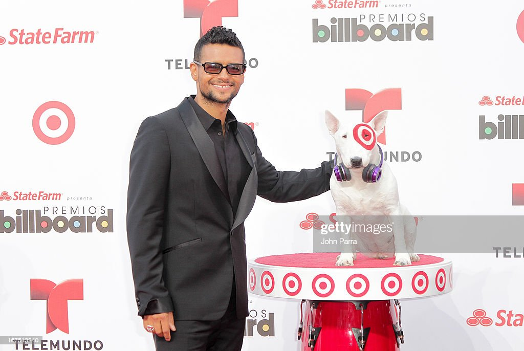 Robi Draco Rosa celebrates with Bullseye, Target's Beloved Bull Terrier Mascot, at the 2013 Billboard Latin Music Awards at BankUnited Center on April 25, 2013 in Miami, Florida.