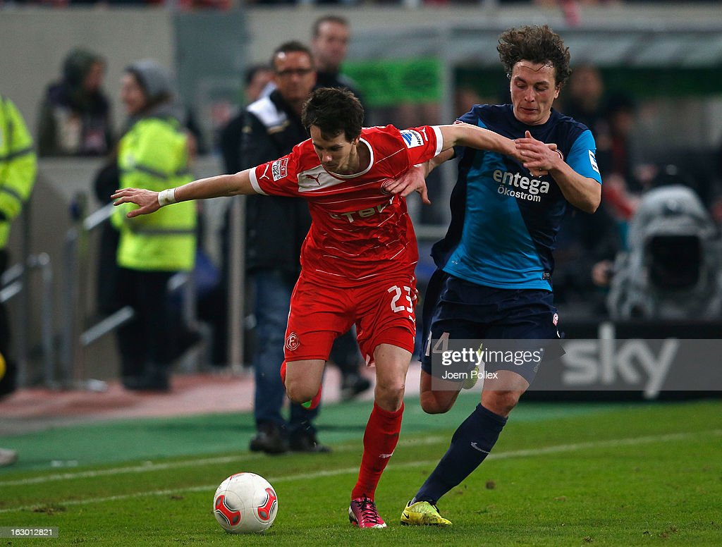 Robie Kruse (L) of Duesseldorf and Julian Baumgartlinger of Mainz compete for the ball during the Bundesliga match between Fortuna Duesseldorf 1895 and 1. FSV Mainz 05 at Esprit-Arena on March 3, 2013 in Duesseldorf, Germany.