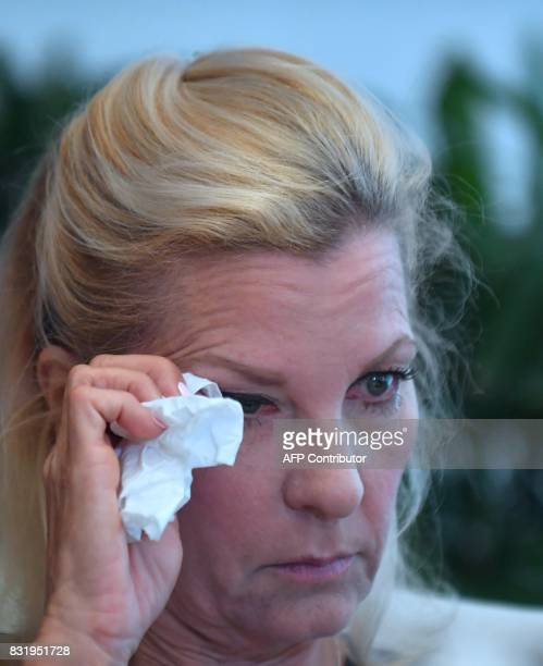 Robin another accuser of Roman Polanski who alleges she was 16 years old when sexually victimized by Mr Polanski wipes a tear from her eye during a...