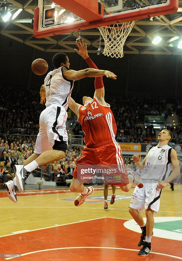 Robin Benzig (C) of Muenchen in blocked by David McCray (L) of Bonn during the Beko Basketball match between FC Bayern Muenchen and Telekom Baskets Bonn at Audi-Dome on December 9, 2012 in Munich, Germany.
