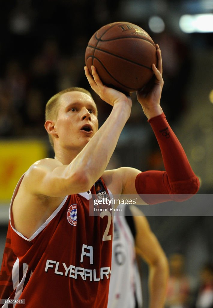 Robin Benzig of Muenchen shoots during the Beko Basketball match between FC Bayern Muenchen and Telekom Baskets Bonn at Audi-Dome on December 9, 2012 in Munich, Germany.