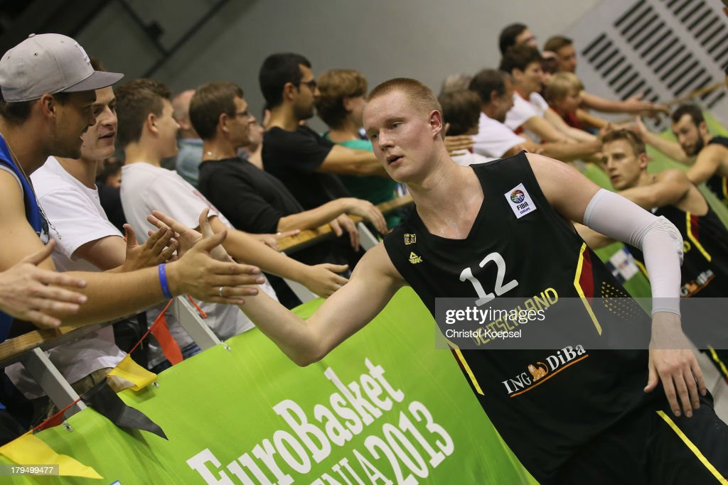 Robin Benzing and Heiko Schaffartzik of Gemany celebrate after the FIBA European Championships 2013 first round group A match between France and Germany at Tivoli Arena on September 4, 2013 in Ljubljana, Slovenia. The match betweenFrance and Germany ended 74-80.