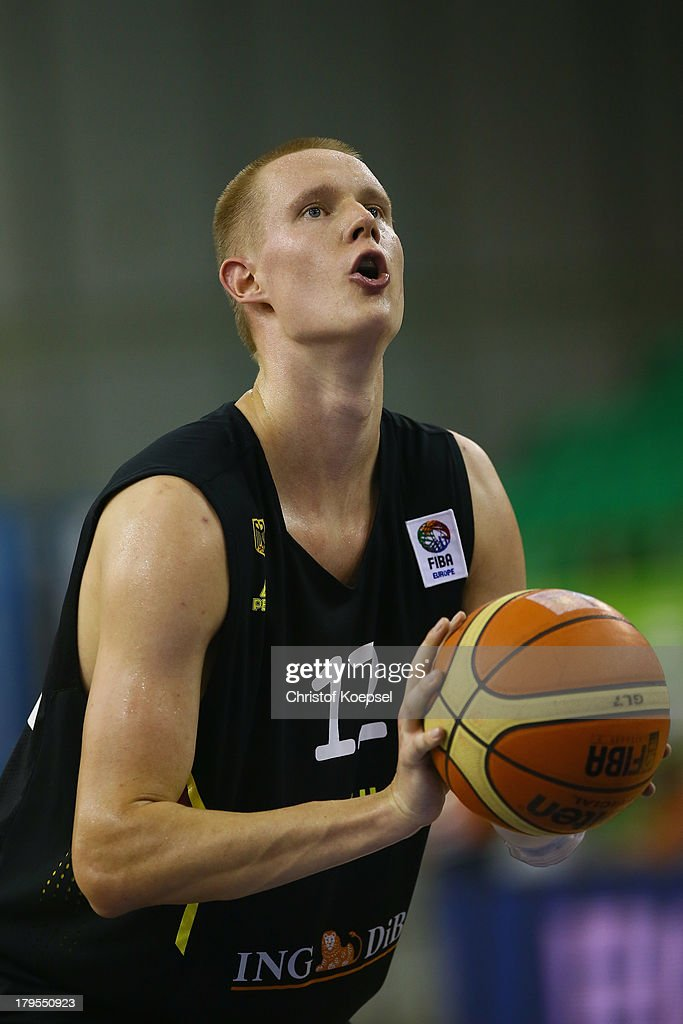 Robin Benzing of Gemany throws the ball during the FIBA European Championships 2013 first round group A match between France and Germany at Tivoli Arena on September 4, 2013 in Ljubljana, Slovenia.