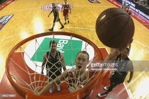 Robin Benzing of Muenchen scores a point during the Beko Basketball Bundesliga match between FC Bayern Muenchen and WALTER Tigers Tuebingen at...