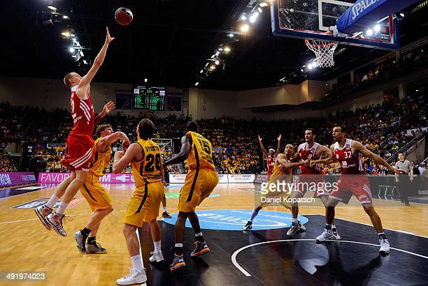 Robin Benzing of Muenchen shoots during the Beko BBL Playoffs semifinal match between MHP RIESEN Ludwigsburg and FC Bayern Muenchen on May 18 2014 in...
