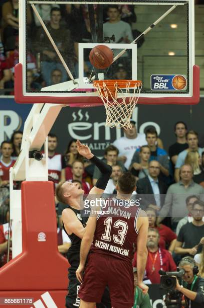 Robin Benzing of Wuerzburg and Milan Macvan of Bayern Muenchen battle for the ball during the easyCredit BBL Basketball Bundesliga match between FC...