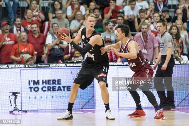 Robin Benzing of Wuerzburg and Nihad Dedovic of Bayern Muenchen battle for the ball during the easyCredit BBL Basketball Bundesliga match between FC...