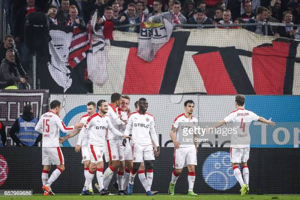 Robin Bormuth of Duesseldorf celebrates with his teammates after scoring a goal to make it 10 during the Second Bundesliga match between Fortuna...