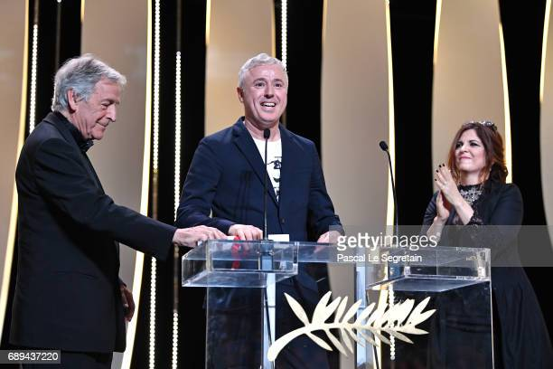 Robin Campillo is seen on the stage with jury member Agnes Jaoui and director CostaGavras after receiving the Grand Prix for the movie '120 Beats Per...