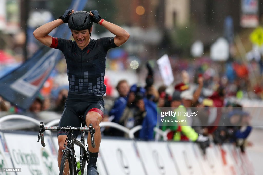 Robin Carpenter of the United States riding for the Hincapie Sportswear Development Team celebrates as he crosses the finish line to win stage two of the 2014 USA Pro Challenge from Aspen to Crested Butte on August 19, 2014 in Crested Butte, Colorado.