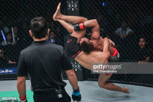 Robin Catalan takes down Dejdamrong Sor Amnuaysirichoke with a spectacular slam during ONE Championship Quest For Greatness at the Stadium Negara on...