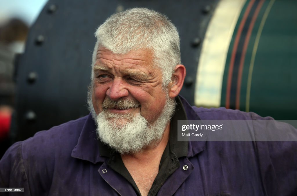 Robin Daniel smiles as he stands besides 'Janet' his 1922 Burrell steam engine that he is preparing to show at the Cornish Steam and Country Fair at the Stithians Showground on August 16, 2013 near Penryn, England. The annual show, now in 58th year, is one of Cornwall's largest outdoor events and is one of the UK's most popular and respected steam rallies.