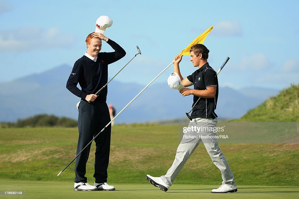 Robin Dawson of GB&I seals victory against Nicolas Manifacier of the Continent of Europe 4&3 during the second day of the Jacques Leglise Trophy at Royal St David's Golf Club on August 31, 2013 in Harlech, Wales.