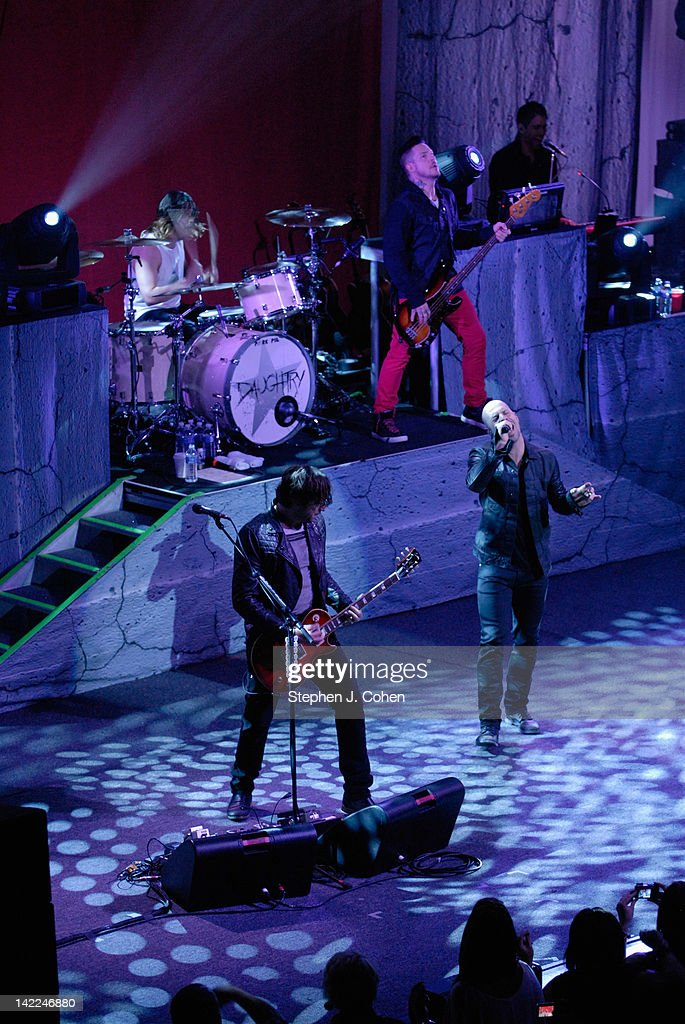 Robin Diaz,Brian Craddock,Josh Paul, and <a gi-track='captionPersonalityLinkClicked' href=/galleries/search?phrase=Chris+Daughtry&family=editorial&specificpeople=614842 ng-click='$event.stopPropagation()'>Chris Daughtry</a> of Daughtry performs at the Louisville Palace on March 31, 2012 in Louisville, Kentucky.