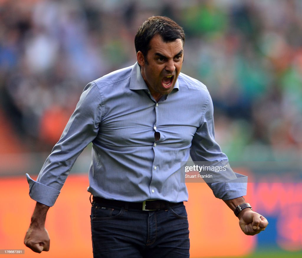 Robin Dutt head coach of Bremen celebrates his first home win as head coach during the Bundesliga match between Werder Bremen and FC Augsburg at...