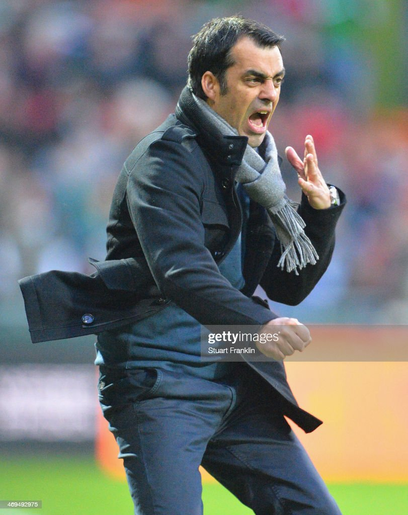 Robin Dutt head coach of Bremen reacts to his teams goal during the Bundesliga match between Werder Bremen and Borussia Moenchengladbach at...