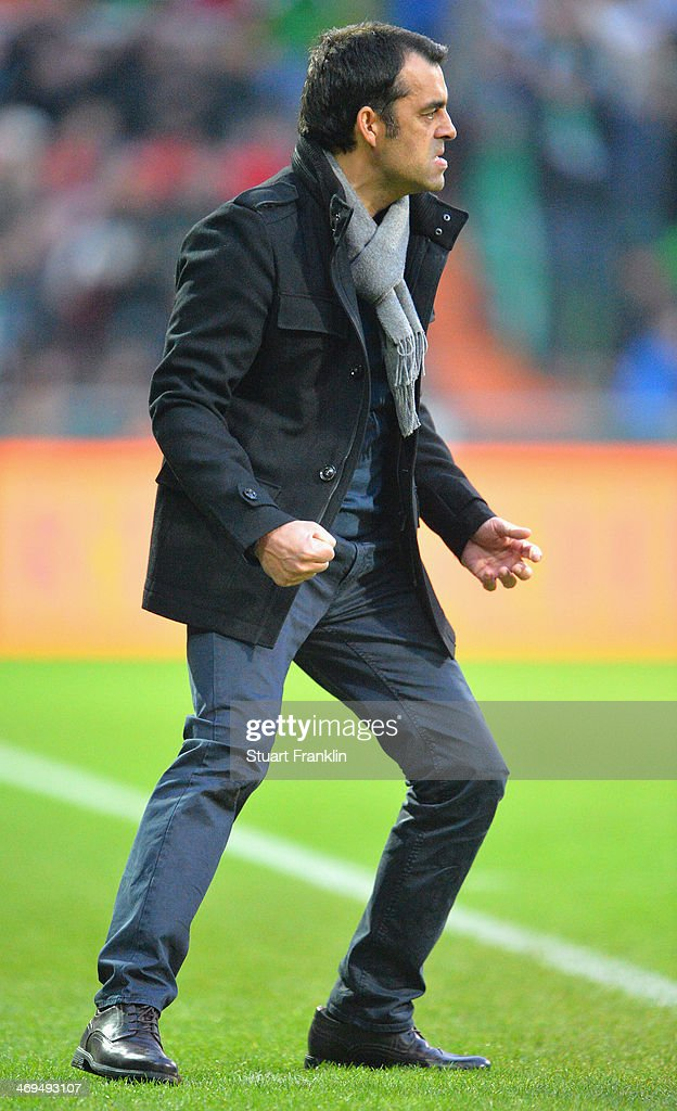 <a gi-track='captionPersonalityLinkClicked' href=/galleries/search?phrase=Robin+Dutt&family=editorial&specificpeople=3175490 ng-click='$event.stopPropagation()'>Robin Dutt</a>, head coach of Bremen reacts to his teams goal during the Bundesliga match between Werder Bremen and Borussia Moenchengladbach at Weserstadion on February 15, 2014 in Bremen, Germany.