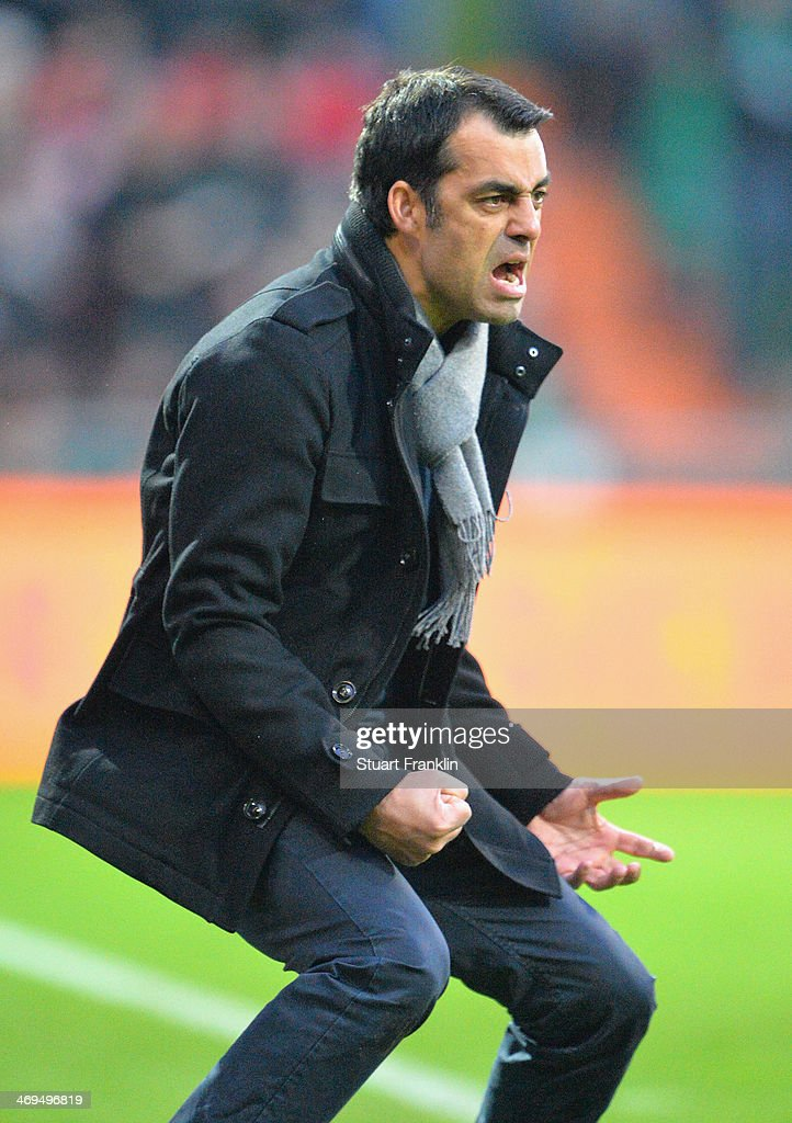 Robin Dutt, head coach of Bremen reacts to his teams goal during the Bundesliga match between Werder Bremen and Borussia Moenchengladbach at Weserstadion on February 15, 2014 in Bremen, Germany.