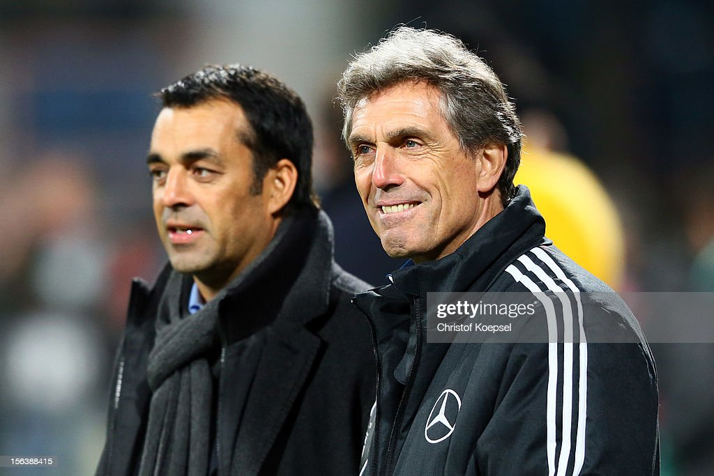 Robin Dutt sporting director of the German Football Association and head coach Rainer Adrion of Germany look on prior to the U21 International...