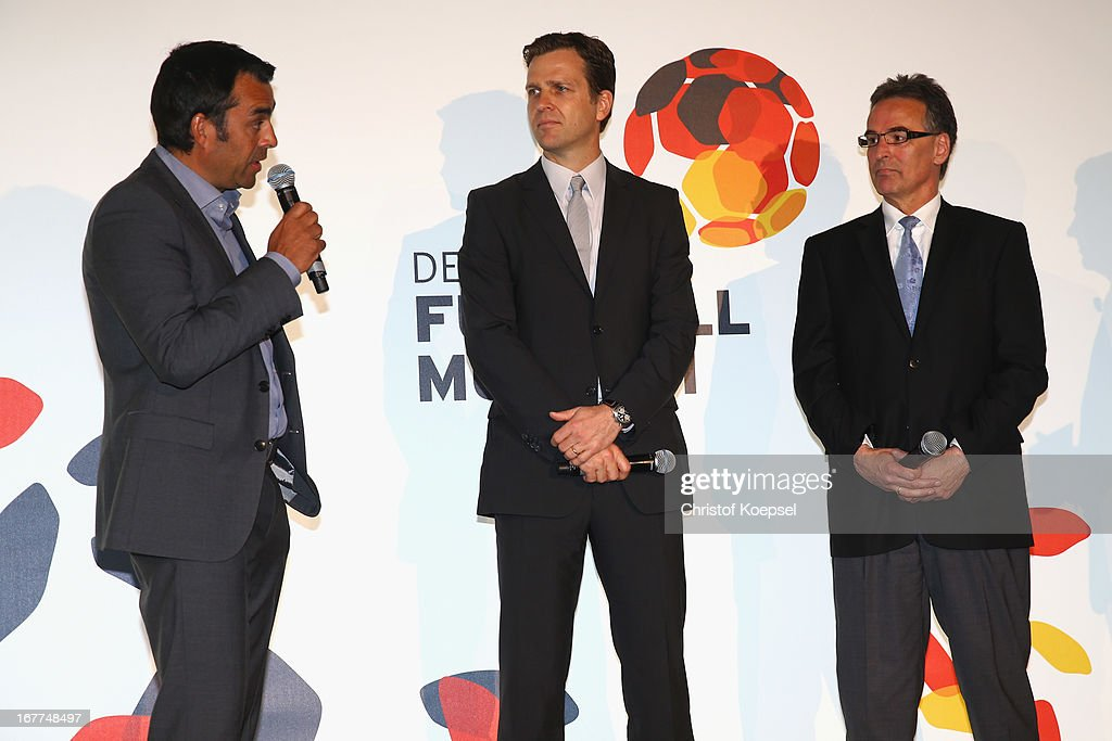 Robin Dutt, sporting director of the German Football Association, Oliver Bierhoff, manager of the German Football Association and Helmut Sandrock, general secretary of the German Football Association talk during the DFB Football Museum groundbreaking ceremony at Harenberg City Center on April 29, 2013 in Dortmund, Germany.