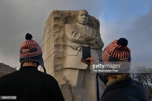 Robin Finstad L and Nicolas Skjelstad snap photos at the memorial for the slain civil rights leader Martin Luther King Jr on Sunday January 17 in...