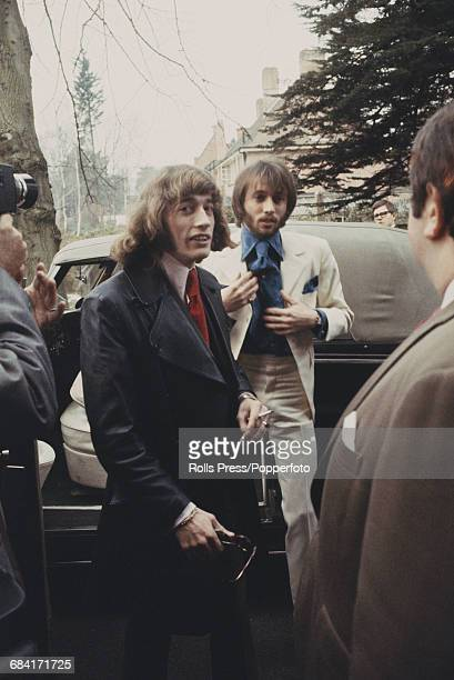Robin Gibb escorts his twin brother Maurice Gibb of the Bee Gees in to St James's Church before Maurice's wedding to Scottish singer Lulu at a...