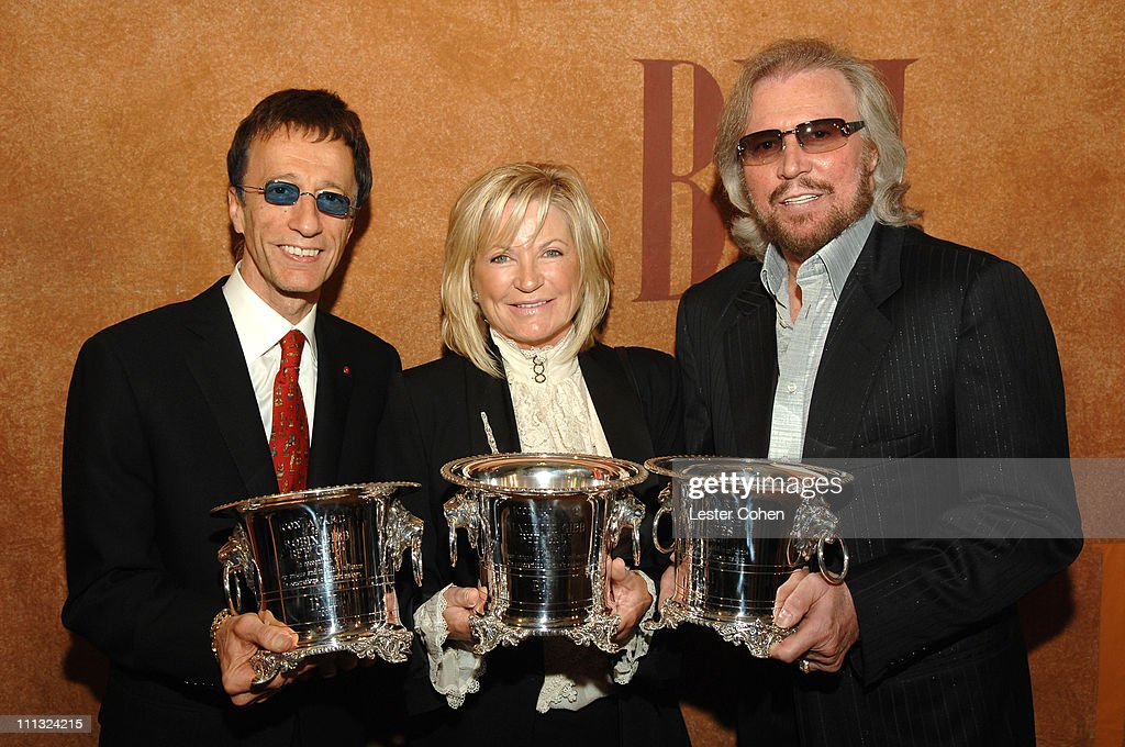 <a gi-track='captionPersonalityLinkClicked' href=/galleries/search?phrase=Robin+Gibb&family=editorial&specificpeople=211371 ng-click='$event.stopPropagation()'>Robin Gibb</a>, Yvonne Gibb (wife of <a gi-track='captionPersonalityLinkClicked' href=/galleries/search?phrase=Maurice+Gibb&family=editorial&specificpeople=214760 ng-click='$event.stopPropagation()'>Maurice Gibb</a>) and <a gi-track='captionPersonalityLinkClicked' href=/galleries/search?phrase=Barry+Gibb&family=editorial&specificpeople=208122 ng-click='$event.stopPropagation()'>Barry Gibb</a>