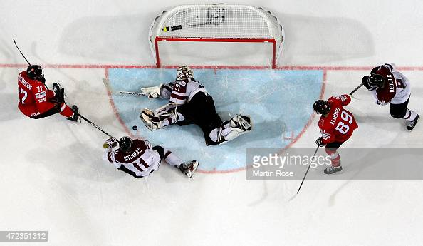 Robin Grossmann of Switzerland fails to score over Edgars Masalskis goaltender of Latvia during the IIHF World Championship group A match between...