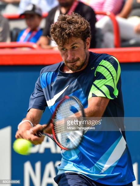 Robin Haase of Netherlands hits a return against Diego Schwartzman of Argentina during day eight of the Rogers Cup presented by National Bank at...