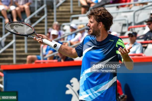 Robin Haase of Netherlands reacts on a call against Diego Schwartzman of Argentina during day eight of the Rogers Cup presented by National Bank at...