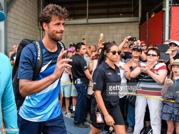 Robin Haase of Netherlands walks past a group of fans after defeating Diego Schwartzman of Argentina during day eight of the Rogers Cup presented by...