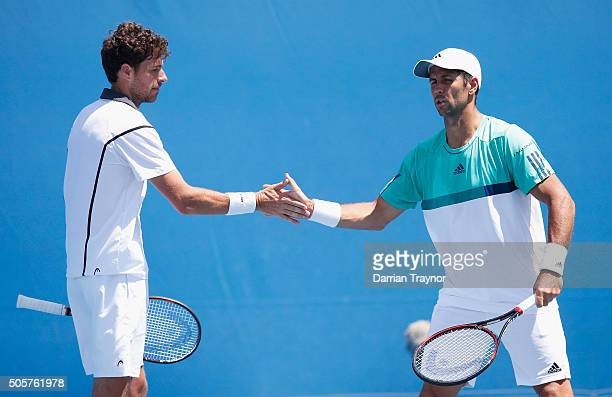 Robin Haase of the Netherlands and Fernando Verdasco of Spain celebrate in their first round match against Jonathan Erlich of Israel and Colin...