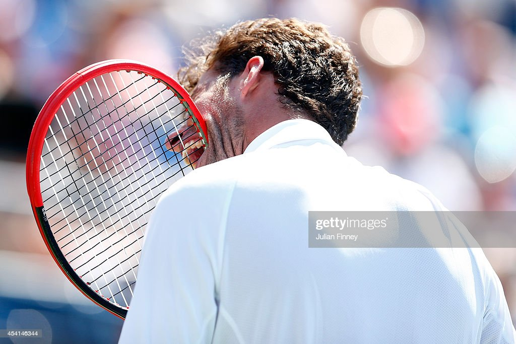 Robin Haase of the Netherlands bites is racquet in frustration against Andy Murray of Great Britain during his men's singles first round match on Day...