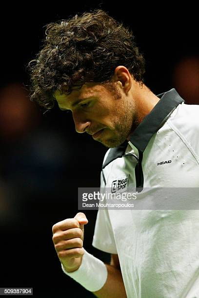 Robin Haase of the Netherlands celebrates winning a point against Gilles Simon of France during day 3 of the ABN AMRO World Tennis Tournament held at...