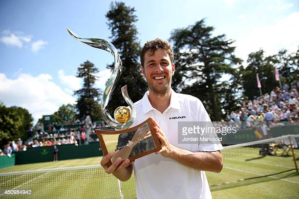 Robin Haase of the Netherlands holds the trophy after defeating JanLennard Struff of Germany in the trophy match on day five of The Boodles Tennis...
