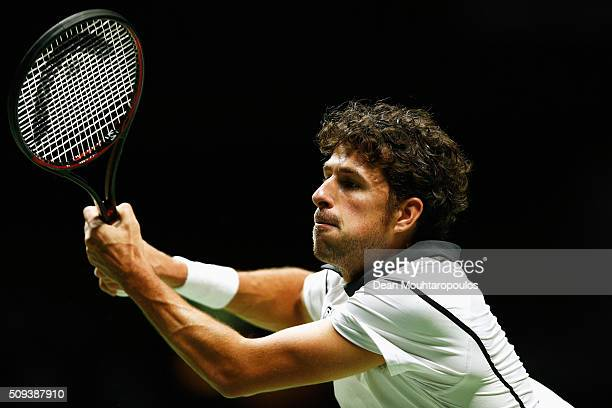 Robin Haase of the Netherlands in action against Gilles Simon of France during day 3 of the ABN AMRO World Tennis Tournament held at Ahoy Rotterdam...