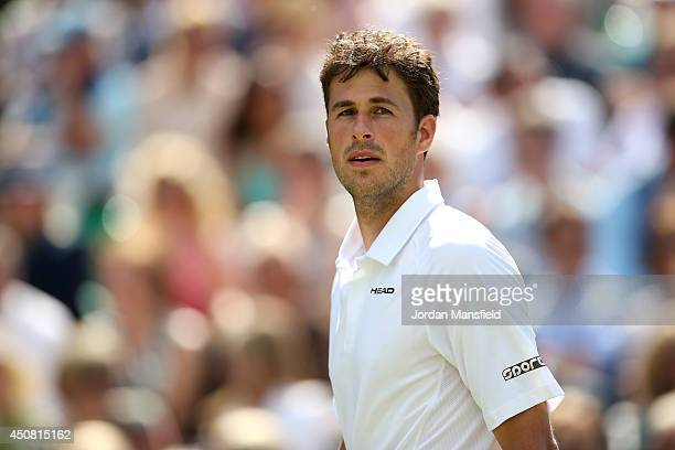 Robin Haase of the Netherlands in action against Milos Raonic of Canada during day two of The Boodles Tennis Event at Stoke Park on June 17 2014 in...