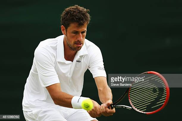 Robin Haase of the Netherlands in action during his Gentlemen's Singles first round match against Vasek Pospisil of Canada on day one of the...