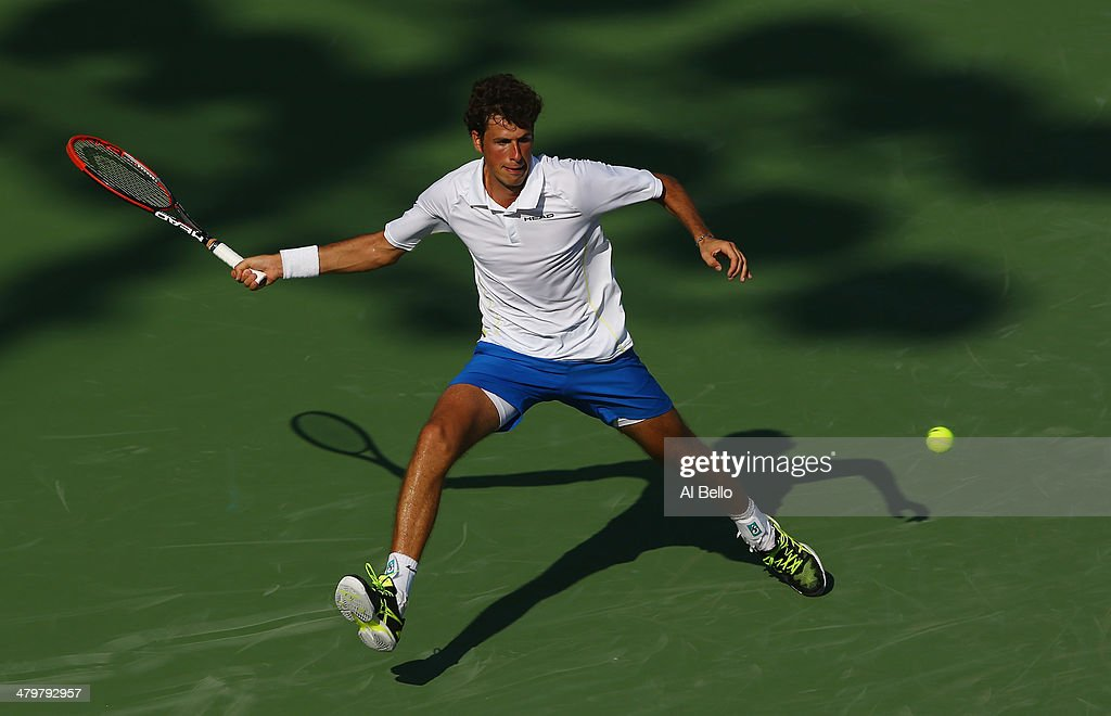 Robin Haase of the Netherlands returns a shot to Lleyton Hewitt of Australia during their match on day 4 of the Sony Open at Crandon Park Tennis Center on March 20, 2014 in Key Biscayne, Florida.