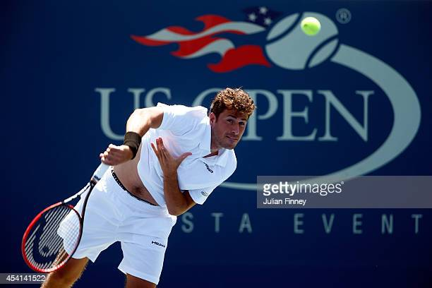 Robin Haase of the Netherlands serves against Andy Murray of Great Britain during his Men's Singles first round match on Day One of the 2014 US Open...