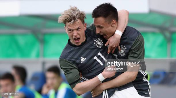 Robin Hack celebrates his team's first goal with team mate Dominik Franke during the UEFA Elite Round match between Germany U19 and Slovakia U19 at...