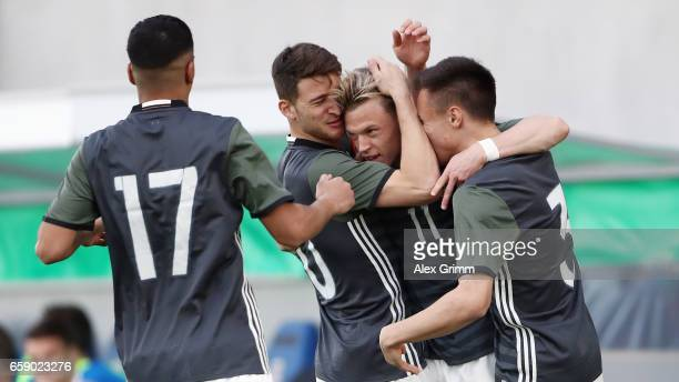Robin Hack of Germany celebrates his team's first goal with team mates during the UEFA Elite Round match between Germany U19 and Slovakia U19 at...