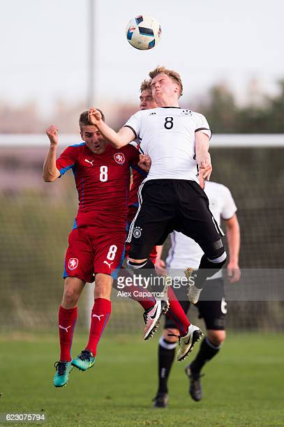 Robin Hack of Germany competes for the ball with Michal Sadilek of Czech Republic during the U19 international friendly match between Czech Republic...
