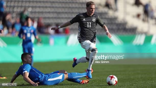 Robin Hack of Germany eludes Andras Lenart of Slovakiaduring the UEFA Elite Round match between Germany U19 and Slovakia U19 at Frankfurter...