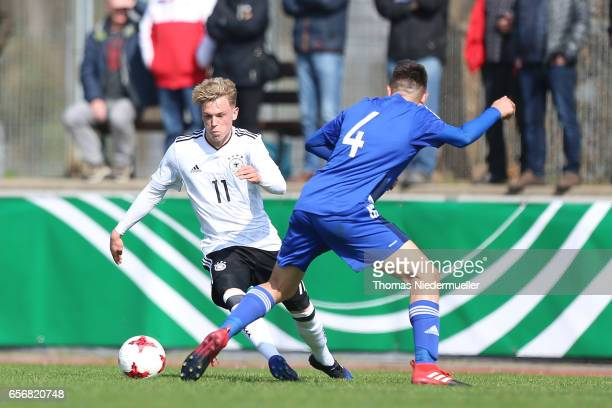 Robin Hack of Germany ifights for the ball with Christos Kallis during the UEFA Under19 European Championship qualifiers between U19 Germany and U19...
