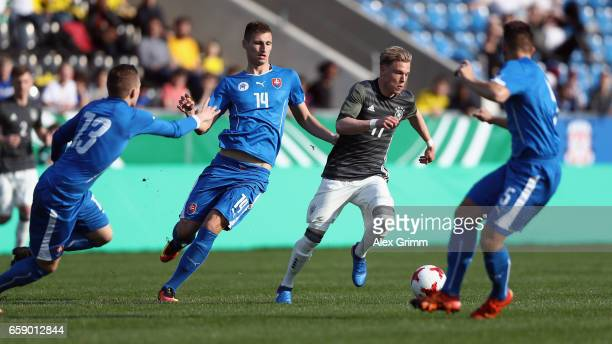 Robin Hack of Germany is challenged by Daniel Dubec of Slovakia during the UEFA Elite Round match between Germany U19 and Slovakia U19 at Frankfurter...