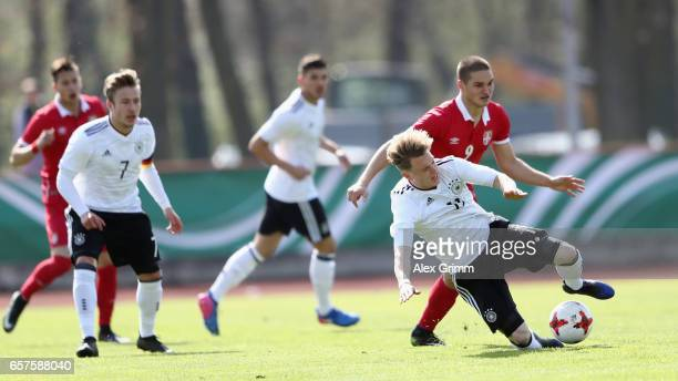 Robin Hack of Germany is challenged by Dorde Jovanovic of Serbia during the UEFA Elite Round match between U19 Germany and U19 Serbia at Sportpark on...